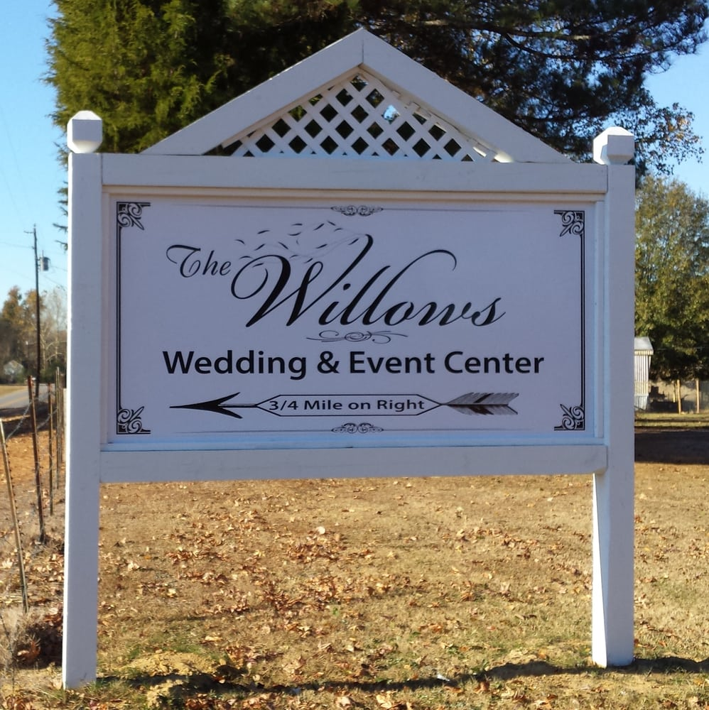 white outdoor sign for the wilsons wedding and event center