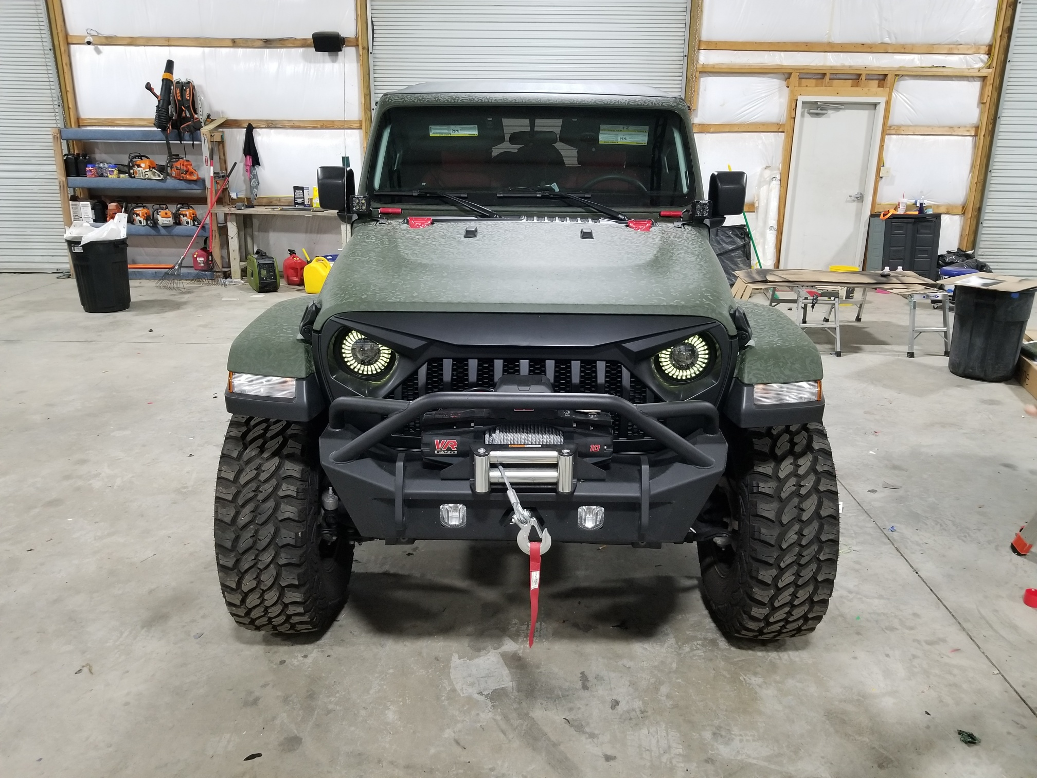 front of green wrapped jeep from sign source