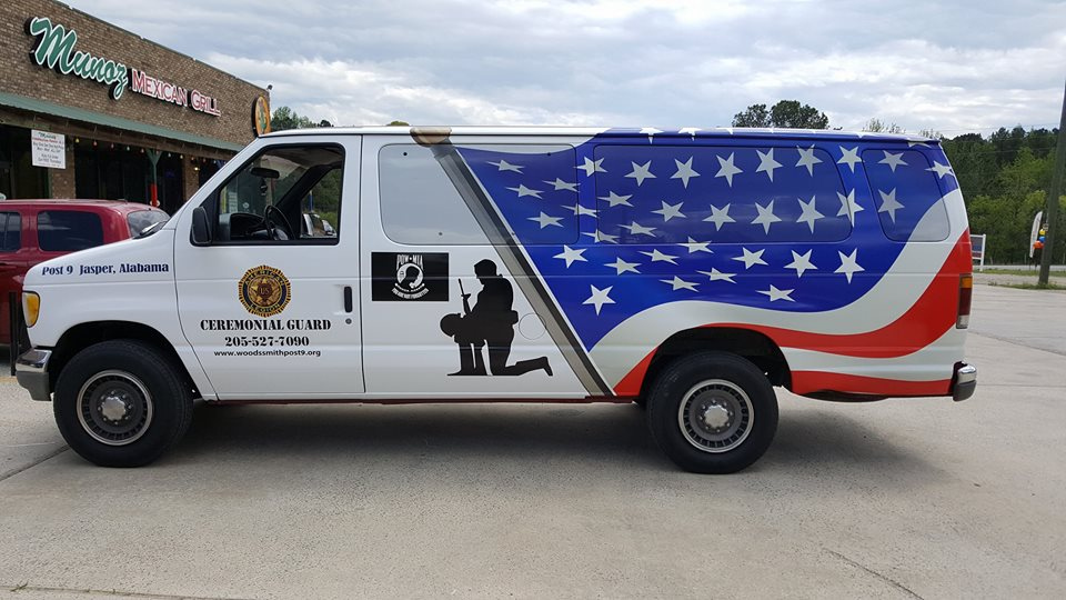 side of red white and blue wrapped van for ceremonial guard