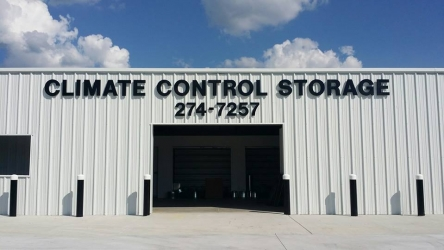 black color Climate control storage signage outside of white business warehouse
