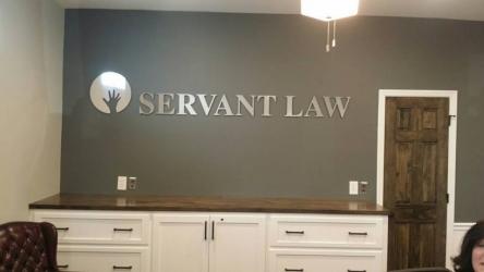 vinyl wall banner for servant law inside an office